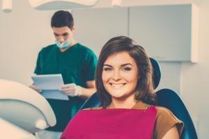 http://www.dreamstime.com/stock-images-woman-dentist-s-surgery-man-reading-women-patient-card-image46336624